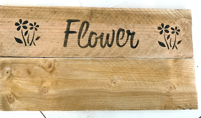How to Make a Flower Garden Sign for under $10. Some wood, a stencil, paint and a few supplies creates a nice addition to your backyard, patio or garden.