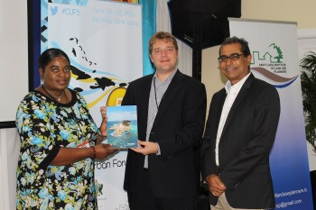 Figure 5: Launch of the UN-Habitat publication: Urbanization and Climate Change in SIDS. (L-R) Ms. Jenny Daniels (SLILUP), Marcus Mayr (UN-Habitat) and Dr. Asad Mohammed (CNULM).