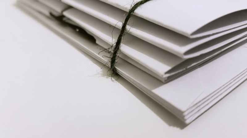 white paper folders with black tie