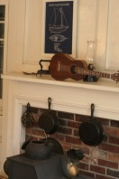 The 1830 parlor features original woodwork and a working woodstove.