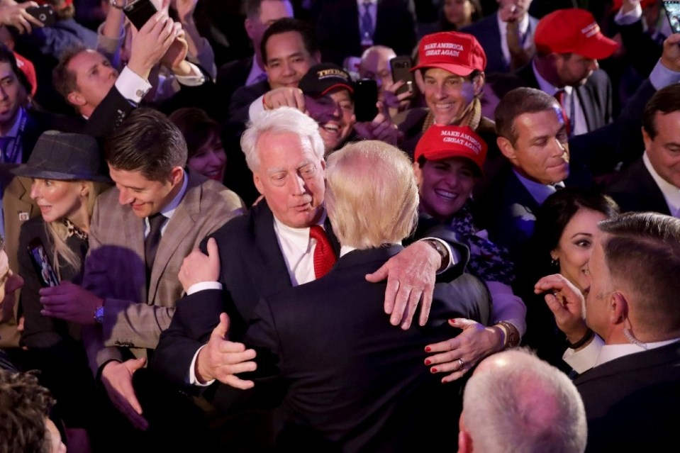 Then president-elect Donald Trump hugs his younger brother in 2016 - CHIP SOMODEVILLA / ©AFP