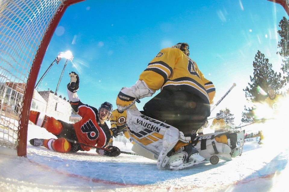 Joel Farabee (L) of the Philadelphia Flyers scores a goal against Boston Bruins netminder Tuukka Rask in the first period during the NHL outdoor game on the shores of Lake Tahoe, Nevada - Christian Petersen / ©AFP