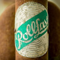 Macro image of a vintage Rollfast bike logo. | Blurbomat.com