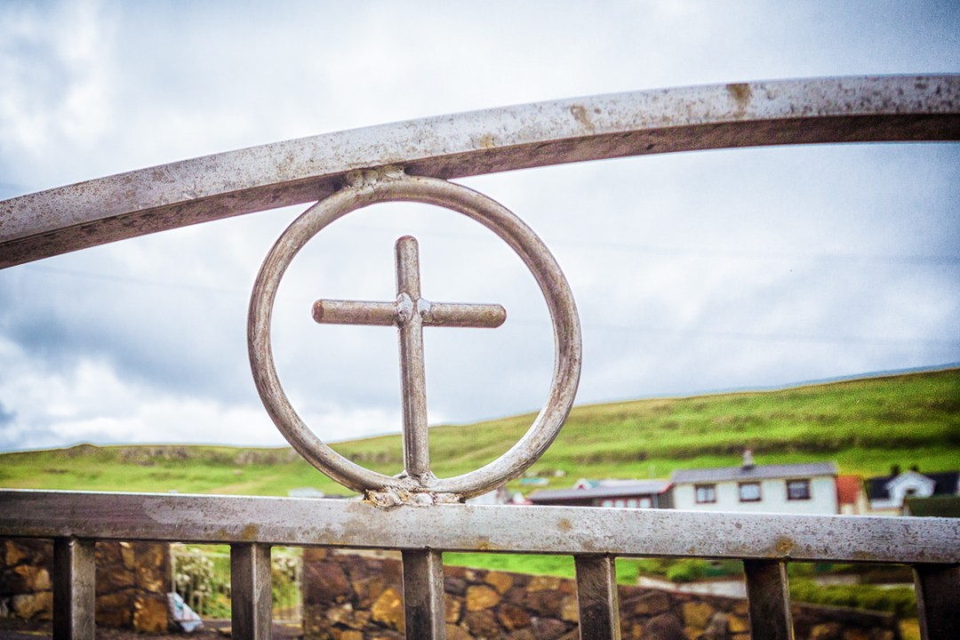 Steel cross in the church gate at Vágur, Suduroy, Faroe Islands.