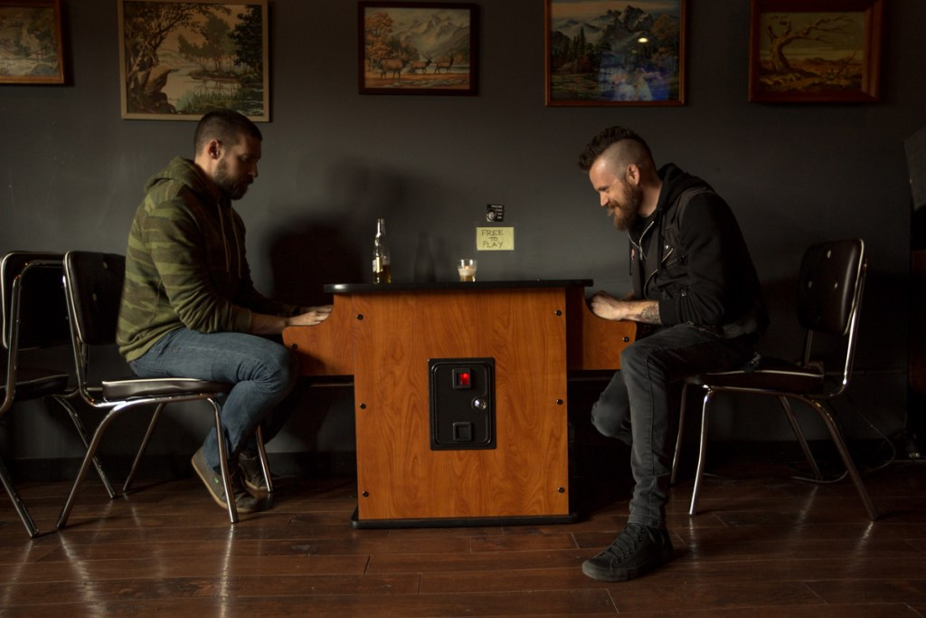 Pre-Show Warm Up, Lincoln and brother Johnny playing video games waiting for the sound man | Photo by Cortney Armitage