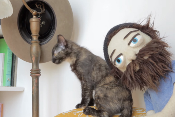 "WATCH A PUPPET PLAY WITH A CAT IN THE VIDEO FOR ""KIRBY"""