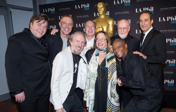 "The Academy presented ""The Oscar Concert"" on Thursday, February 28, at the Walt Disney Concert Hall in Los Angeles. Pictured (left to right): Benjamin Wallfisch, Michael Abels, Charles Bernstein, Hans Zimmer, Laura Karpman, Thomas Wilkins, John Williams and Alexandre Desplat. Photo by Paul Hebert/ (C) A.M.P.A.S. Used with permission."