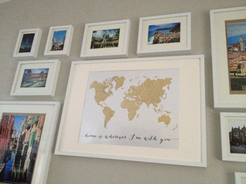 Gold glitter world map in a gallery wall. Image courtesy of Kelly.