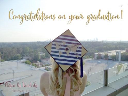 Graduation cap made by Kimberly featuring a gold glitter world map.