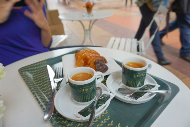 Espresso and a chocolate croissant in Sitges, Spain