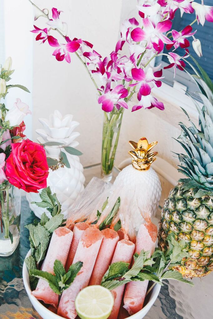 DIY Watermelon Margarita Boozy Popsicles with fresh mint and limes used as a garnish for a tropical bridal shower