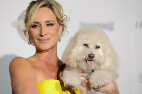 Sonja Morgan poses on the red carpet with her pup