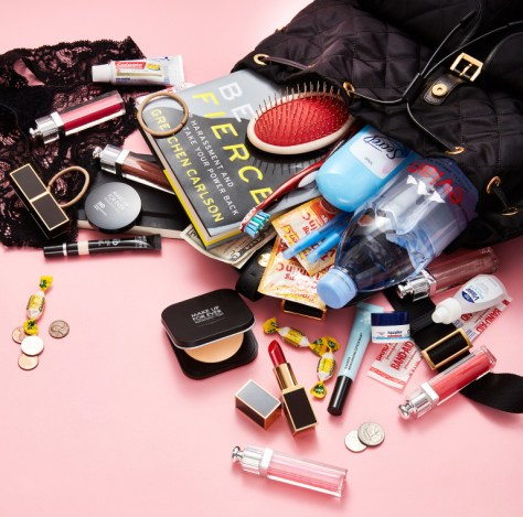 Erika Jayne's What's in my bag with Us magazine included 5 Dior lip glosses! Plus some Tom Ford lipsticks.