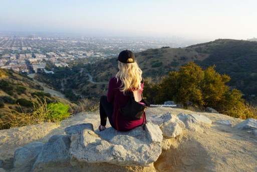 Me looking over the city of LA from the top of Runyon Canyon wondering what the top 5 best things to do in Hollywood are...