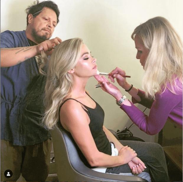 Carlos Ortiz working on Denise Richards hair with makeup artist Joanna Schlip Photo: @carlitos_hair on Instagram