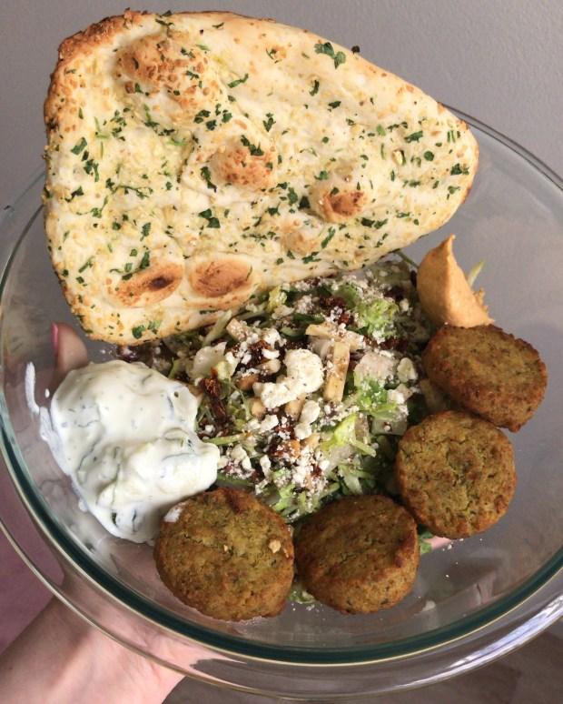 Trader Joe's Mediterranean Salad Kit with extra feta, falafel, tzatziki, spicy hummus, and garlic naan