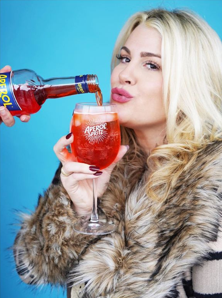 Heather McMahan drinking an Aperol Spritz
