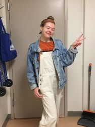 Grace posing in Fiona's overalls and jean jacket looking like a farmer