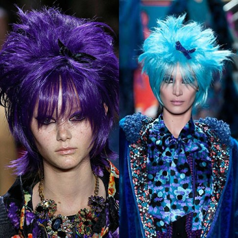 From designer Anna Sui, two models wearing spiked, cropped wigs-one in purple and one in light blue