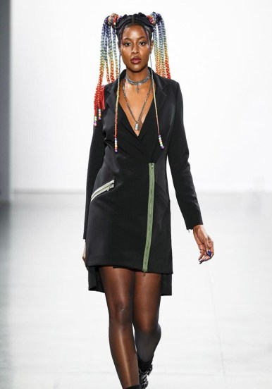 Rapper JZL the Empress had her hair in rainbow-colored braids styled into pigtails for Nicole Miller's show