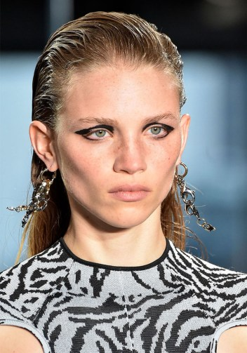 Proenza Schouler slicked a model's hair back into a mullet.