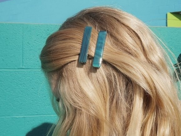 blue hair clips in blonde hair