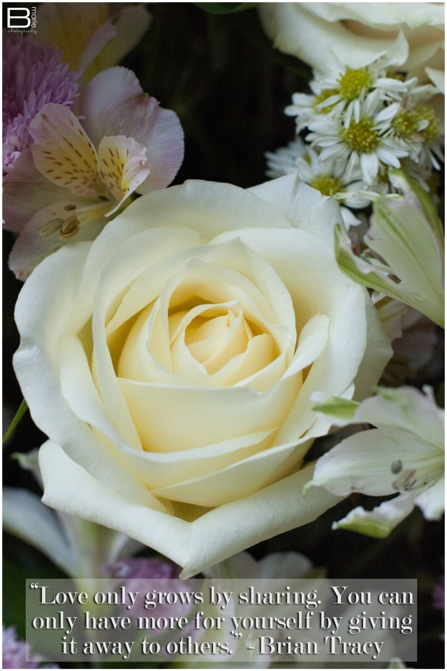 Nacogdoches photographer inspirational quote by Brian Tracy on an image of a floral arrangement with a full white rose