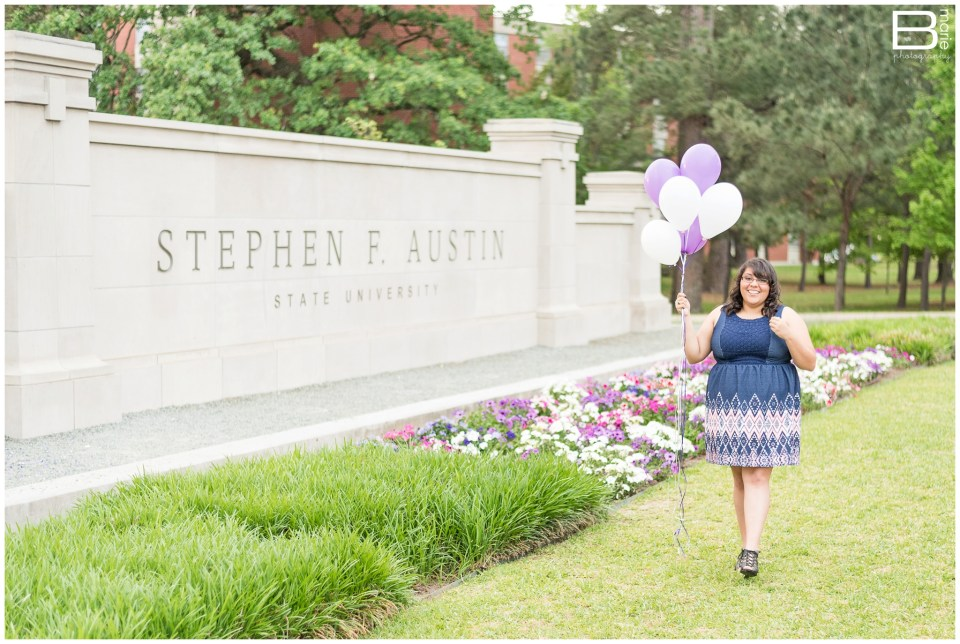Nacogdoches photographer senior portraits on SFA campus with purple & white balloons