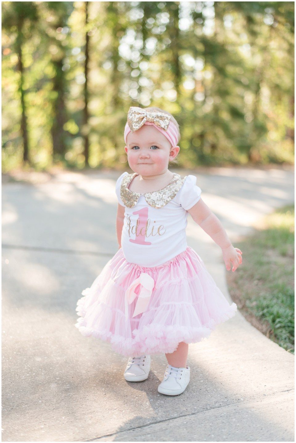 Kingwood child photographer 1 year milestone session with little girl in pink & gold sequin outfit