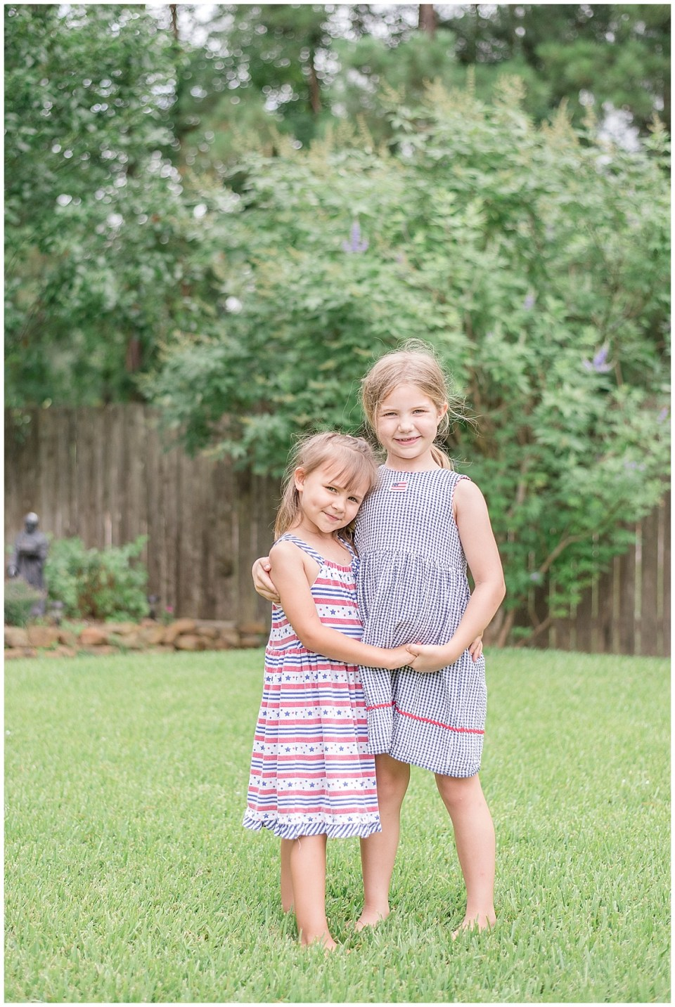 Kingwood photographer images of daughters in patriotic dresses for 4th of July