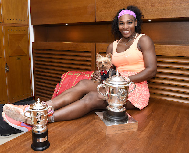 Serena Williams of the U.S. and her dog Chip pose in the cloakroom after winning the French Open Tennis tournament against Lucie Safarova of the Czech Republic, at the Roland Garros stadium in Paris, France, Saturday, June 6, 2015. Williams won 6-3, 6-7, 6-2. (Corinne Dubreuil, FFT, Pool via AP)