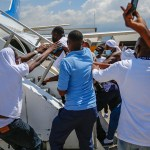 Expelled Haitian migrants try to get back on plane returning to US