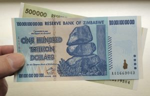 Harare, Zimbabwe - September 18th 2015: Banknotes from Zimbabwe that were printed during a period of hyper-inflation that culminated in this Hundred Trillion Dollar bill -which when issued wouldn't  buy a loaf of bread