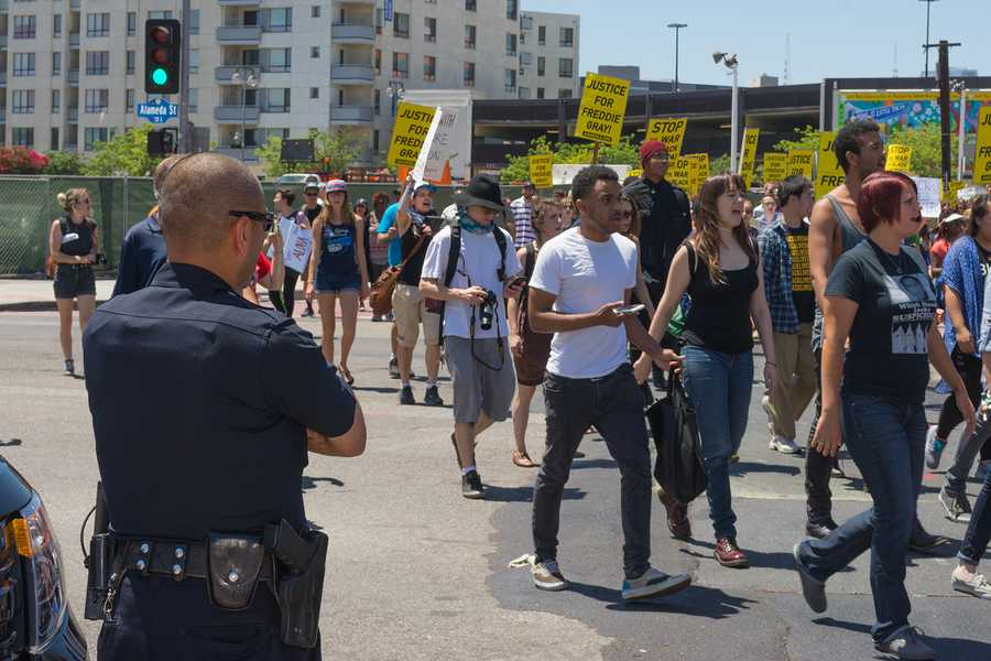 Los Angeles CA USA - May 02 2015: Police watching Protesters during march against the death of Freddie Gray a man of Baltimore who was seriously injured in police custody.