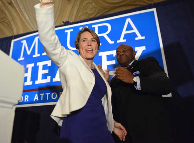 Attorney General-elect Maura Healey, D-Mass., celebrates her victory over Republican opponent John Miller, on Tuesday, Nov. 4, 2014 in Boston. Also seen is former interim Mass. Sen. William