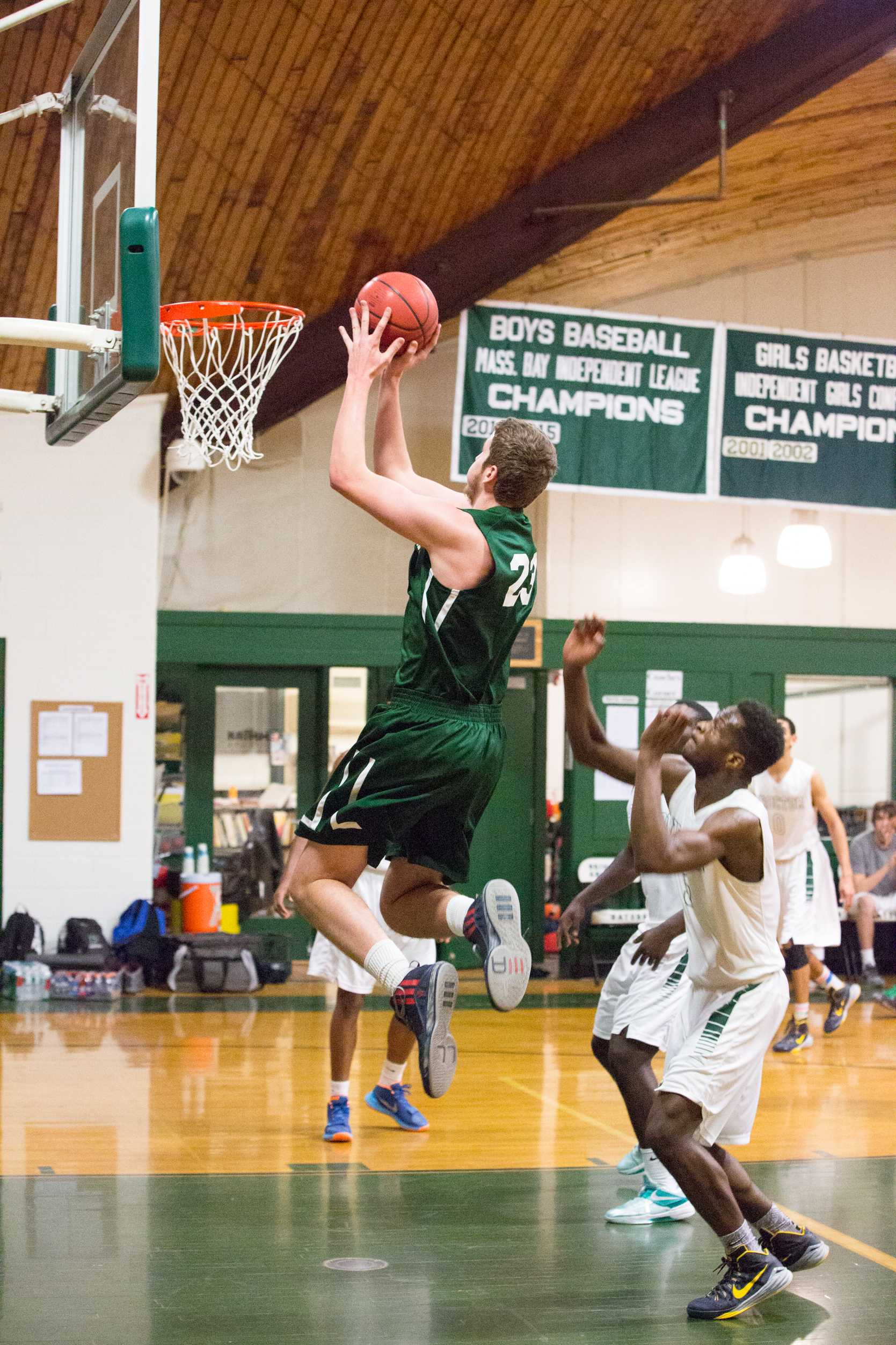 Mark Gasperini '16 goes hard to the hoop. Photo by David Barron.