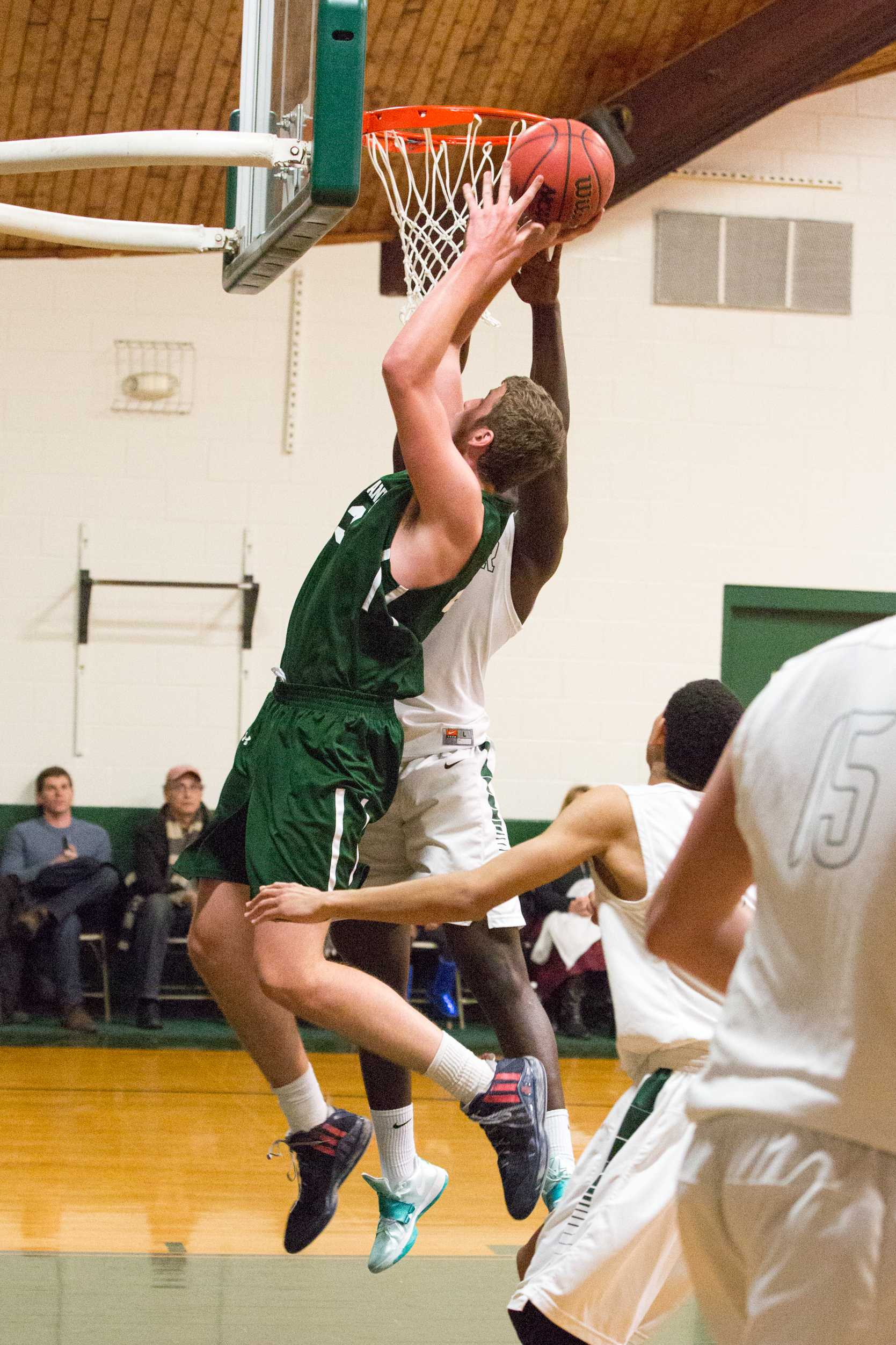 Mark Gasperini '16 takes it to the rim. Photo by David Barron.