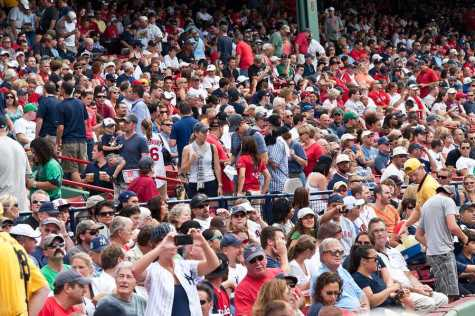 Boston - August 8: New York Yankees and Boston Red Sox fans in the stands on August 8 2011 at Fenway Park in Boston Massachusetts.