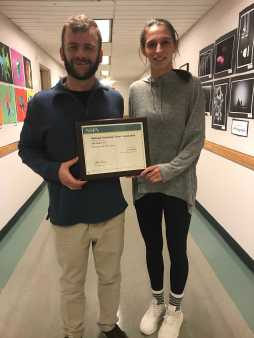 Gator Adviser David Cutler and Editor Shani Breiman show off the 'First Class' NSPA journalism award. Photo by Sophie Lapat 18.