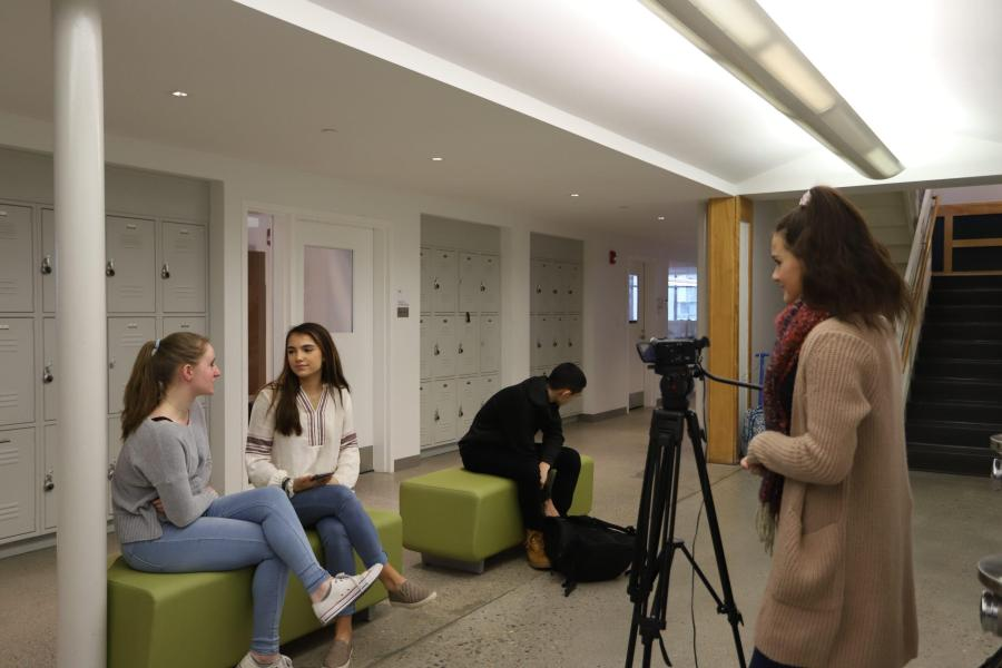 GNN reporter Angeline Nur '21 interviewing students about the first semester. Photo by Caroline Ellervilk '18.