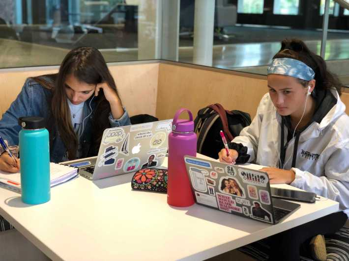 Hannah Ahearn '20 and Angeline Nur '21 working on their homework. Photo By Sita Alomran '19