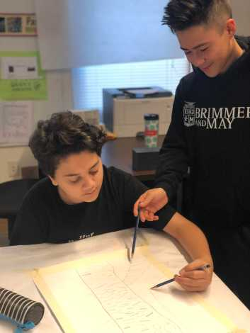 Brain Barrera '22 and Lucca Picon-Roura '22 working on a drawing sketch. Photo By Sita Alomran '19