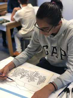 Neel Kumar '22 working on his Studio Art project. Photo By Sita Alomran '19