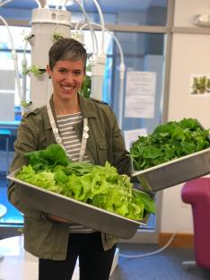 Librarian Megan Dolan displays the produce from the Tower Gardens. Photo By Abby Mynahan '19.