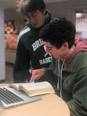 "Joshua ""Josh"" Poresky '19 and Justin Ewing '19 discussing their English novel. Photo By Sita Alomran '19."