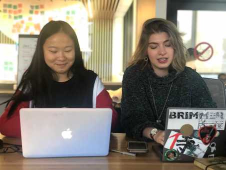 Kitty Huang '21 discussing voice edits for GNN with classmate Michelle Levinger '19. Photo by Sita Alomran '19.
