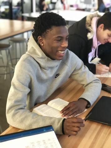 Kyrell Luc '21 working on his English III annotations. Photo By Gianni Thompson '21.