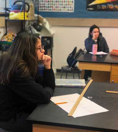 Laura Lopez '19 sketching a timeline for archeology class. Photo By Sita Alomran '19.