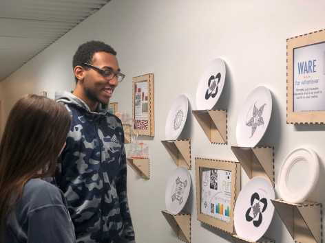 Alphonse Houndegla '21 and Molly McHugh '21 observing problem solving through design's projects. Photo By Sita Alomran '19.