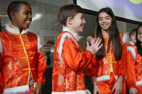Sixth grade students perform a Chinese song. Photo by Michelle Levinger '19.